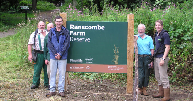 Photo of Ranscombe Farm Sign with volunteers