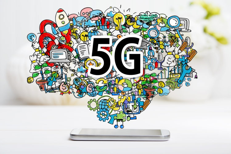 5G concept with smartphone on white table